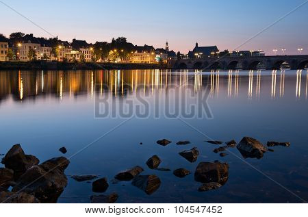 Maastricht across the river by night