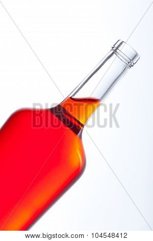 Close up of bottle with red fluid
