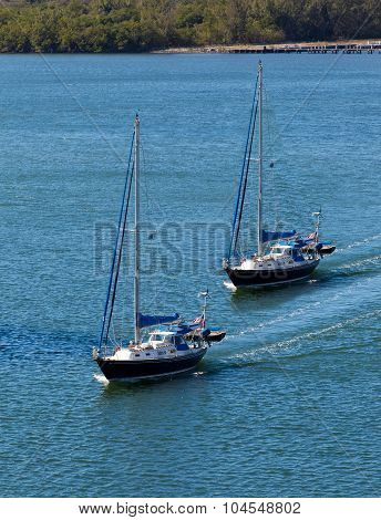 Two sail boats navigating