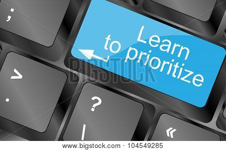 Learn To Prioritize. Computer Keyboard Keys With Quote Button. Inspirational Motivational Quote. Sim