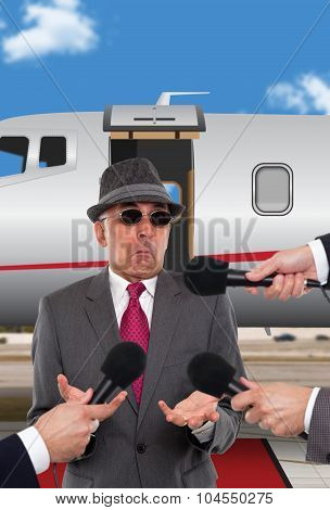 Businessman being interviewed in front of corporate jet