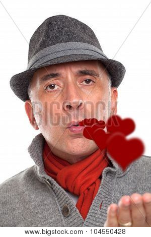 Portrait of a man blowing kisses