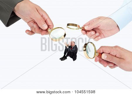 Hands with magnifier glasses looking, studying or selecting a person