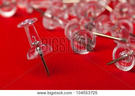 Push pins on red board