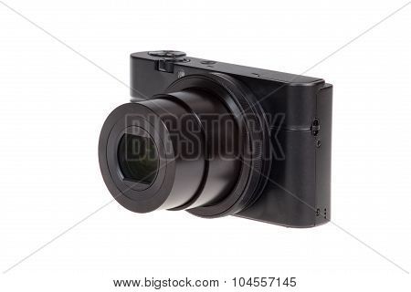 Digital Compact Camera With Open Lens Isolated On White