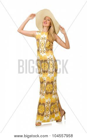 Young woman wearing hat and long summer dress isolated on white