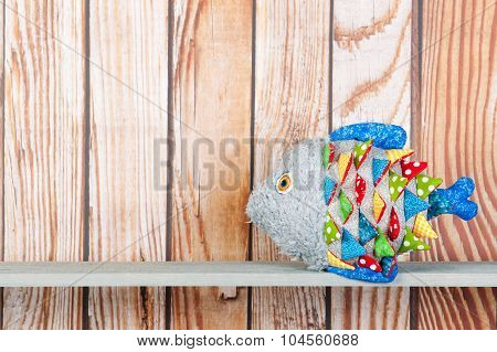 Stuffed Funny Fish On Wooden Background