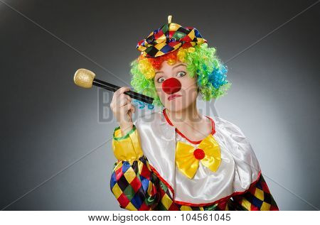 Clown with mic in funny concept