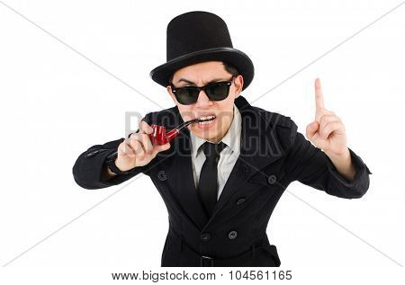Young detective in black coat  holding smoking pipe isolated on white