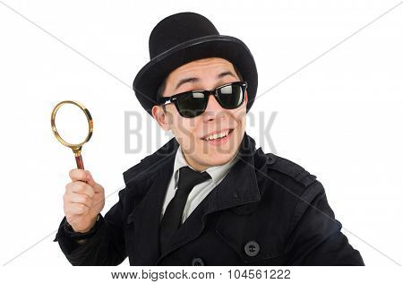 Young detective in black coat holding magnifying glass isolated on white