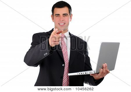 Young businessman holding laptop pointing finger forward