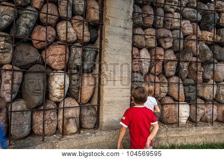Moscow, Russia - September 25, 2015:  City artistic park Muzeon. Victims of totalitarian regime, author Chubarov. Fragment, children.