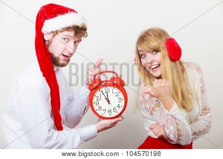 Happy Couple Woman And Man With Alarm Clock.