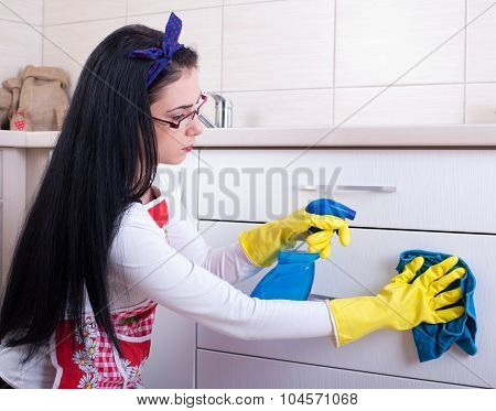 Woman Cleaning Kitchen Drawers