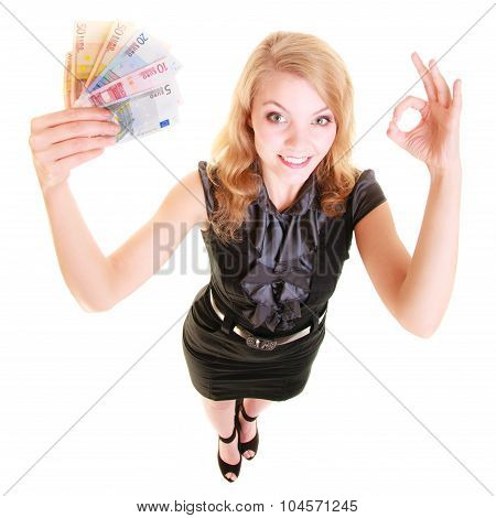Economy Finance. Woman Holds Euro Currency Money.