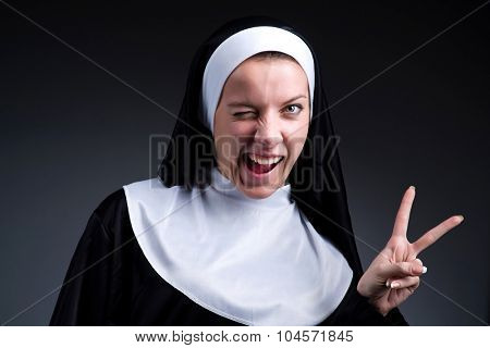 Funny nun showing victory sign