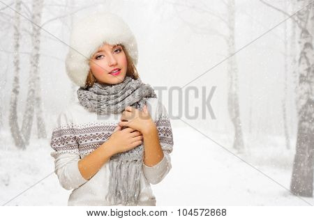 Young smiling girl at snowy forest