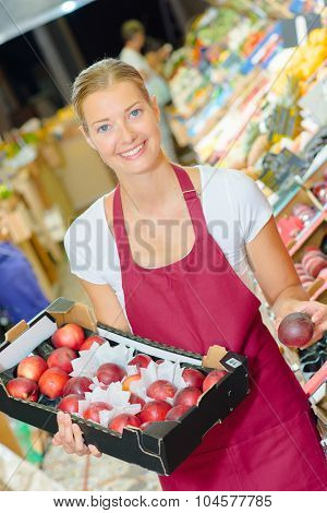 Woman working in the fruit aisle
