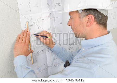 Architect writing on his blue prints