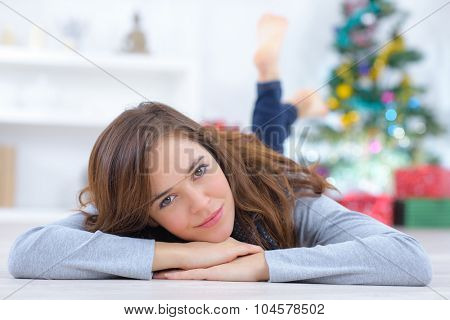 Woman laying on the floor at home