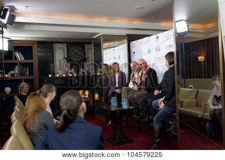 ST. PETERSBURG, RUSSIA - OCTOBER 9, 2015: Wedding stylist Mauro Adami (orange scarf) presenting his collection in Corinthia Hotel. The platinum wedding gown worth $400,000 exhibited here next 2 days