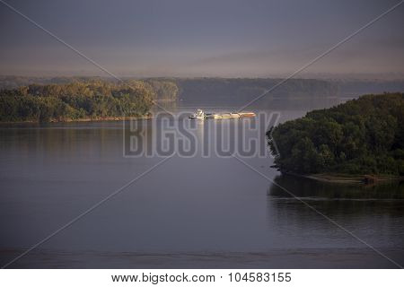 barge on Mississippi River, morning