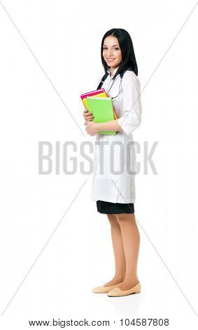 Smiling medical doctor woman with stethoscope and books, isolated on white background