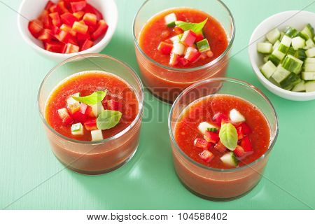 cold gazpacho soup in glasses and ingredients