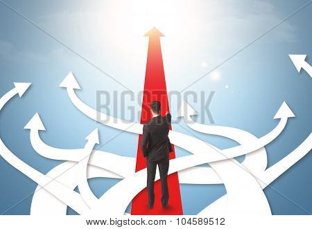 Concept of confused businessman with different direction arrows