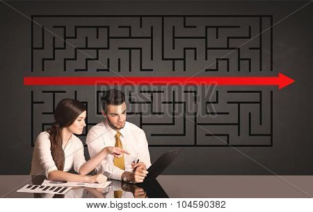 Successful business couple with a solved puzzle in background
