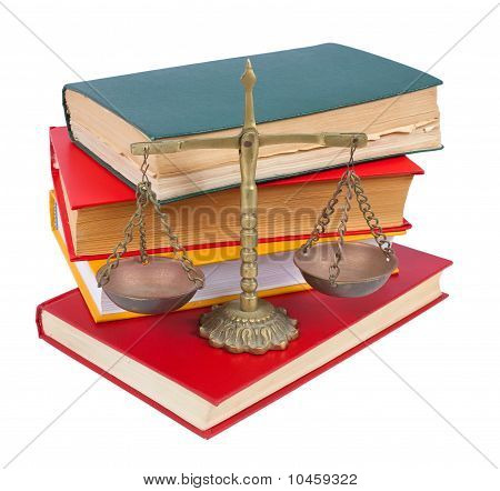Scales Of Justice Atop  Books