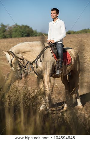 Attractive man on horseback,