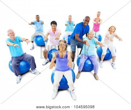 Group Of Multi-Ethnic Senior Adults Exercising Yoga Concept