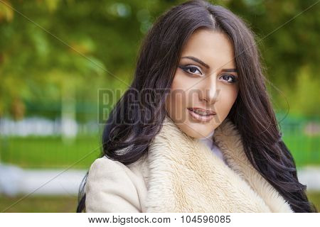 Facial portrait of a beautiful arab woman warmly clothed autumn outdoor