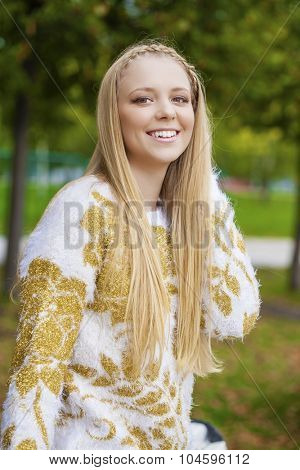Portrait close up of young beautiful blonde women, on golden background autumn nature