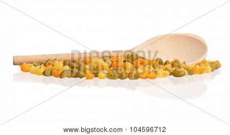 Raw pasta with wooden spoon, isolated on white background
