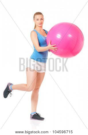 Portrait of fitness woman with pink fitness-ball on white background