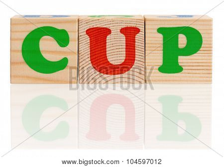 CUP word formed by wood alphabet blocks, isolated on white background