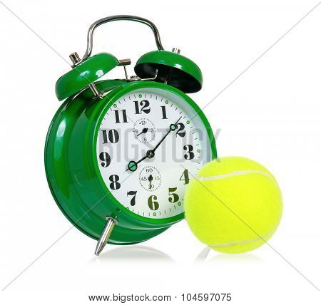 Big green alarm clock with tennis ball, isolated on white background