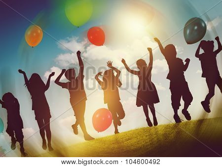 Children Outdoors Playing Balloons Together Concept