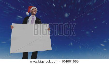 Christmas Businessman Holding Blank Placard Concept