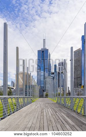 Footbridge with cityscape in the background