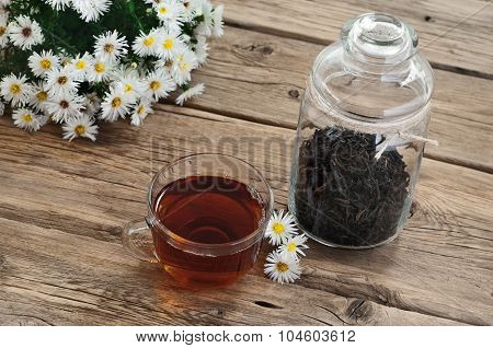 Tea With A Bouquet Of Daisies
