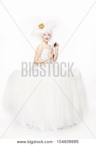 Princess with a golden crown in a white dress. Nobility.