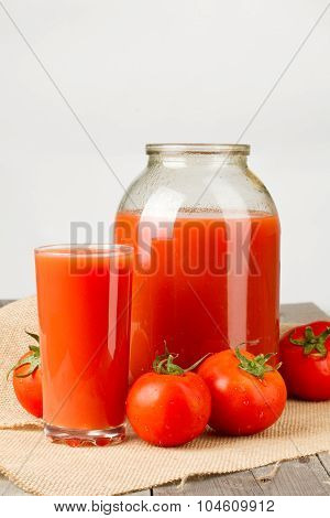 Tomato Juice In Glass And Two Liter Jar