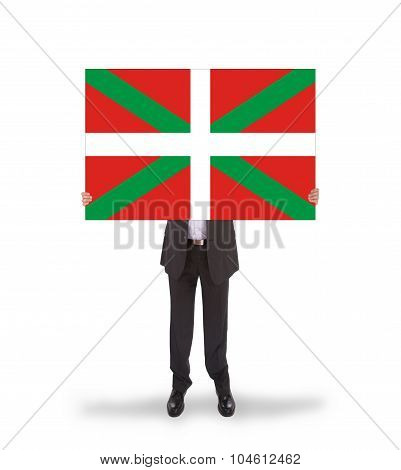 Smiling Businessman Holding A Big Card, Flag Of Basque Country