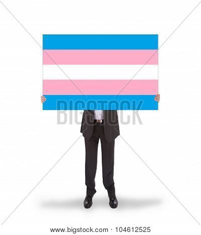 Smiling Businessman Holding A Big Card, Flag Of Trans Pride