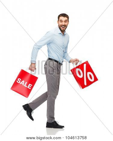 people, sale, discount and holidays concept - smiling man walking with red shopping bags