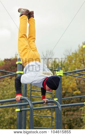 ST. PETERSBURG, RUSSIA - OCTOBER 10, 2015: Unidentified athlete competes in freestyle during the qualifying stage of Street Workout World Cup