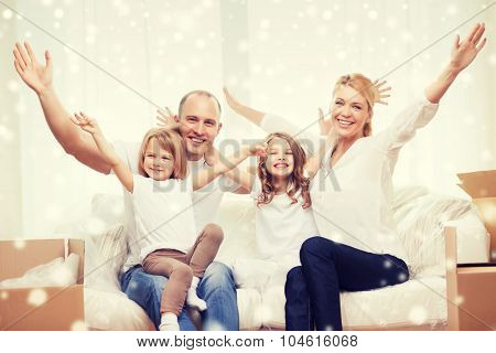 family, people, accommodation, gesture and happiness concept - smiling parents and two little girls moving into new home and waving hands over snowflakes background